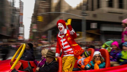 "FILE - In this Thursday, Nov. 26, 2015, file photo, Ronald McDonald waves to the crowd during the Macy's Thanksgiving Day Parade, in New York. McDonald's says Ronald McDonald is keeping a low profile with reports of creepy clown sightings on the rise. McDonald's Corp. said Tuesday, Oct. 11, 2016, that it is being ""thoughtful in respect to Ronald McDonald's participation in community events"" as a result of the ""current climate around clown sightings in communities."" The company did not provide any other details about how often its red-haired mascot makes appearances, and how that will change. The move comes after a rash of hoaxes and pranks about scary clown sightings around the country, which have forced police to check for real threats. (AP Photo/Andres Kudacki, File)"