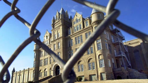 FILE - In this January 2001 file photo, the old Tennessee State Penitentiary is seen through a fence in Nashville, Tenn. The state Department of Correction on Oct. 12, 2016, posted a video featuring drone footage of the crumbling facility that was shuttered in 1992 and was once a favorite film location. (AP Photo/Mark Humphrey, file)