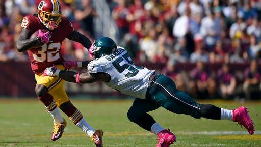 Washington running back Rob Kelley, left, pushes away Eagles defensive end Brandon Graham during the Eagles' 27-20 loss last Sunday.