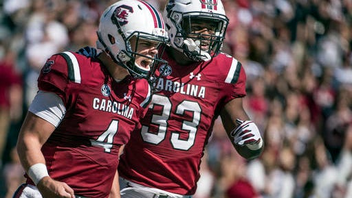 South Carolina starting quarterback Jake Bentley (4) and South Carolina running back David Williams (33) celebrate a touchdown during the first half of an NCAA college football game Saturday, Oct. 22, 2016, in Columbia, S.C.