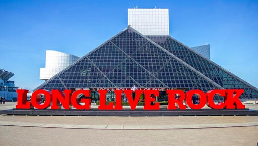 "This photo provided by Rock & Roll Hall of Fame shows the new ""Long Live Rock"" sign outside the Rock and  Roll Hall of Fame in Cleveland.  The outdoor sign will be formally dedicated Thursday, Nov. 10, 2016 as officials share details of a multimillion-dollar redesign expected to include the Hall of Fame and main exhibit spaces."