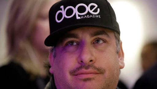 Jason Rosenberg, a sales executive with Dope magazine, attends a rally in support of Prop 64 at Sparc Dispensary Tuesday, Nov. 8, 2016, in San Francisco. California voters approved a ballot measure Tuesday allowing recreational marijuana in the nation's most populous state. (AP Photo/Marcio Jose Sanchez)