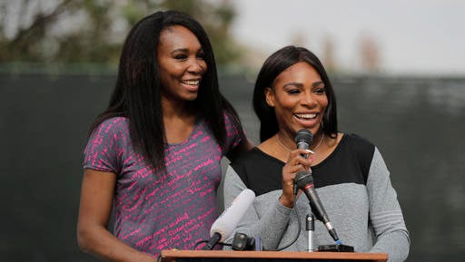 CORRECTS PARK SPELLING TO LUEDERS, NOT LEUDERS - Sister Venus and Serena Williams, right, speak during a dedication ceremony of the Lueders Park tennis courts Saturday, Nov. 12, 2016, in Compton, Calif. The courts were dedicated in their name.
