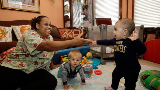 In this Thursday, Oct. 20, 2016, photo, Nancy Harvey, owner of Lil' Nancy's Primary Schoolhouse, left, cares for toddlers at her home, which has she has converted into a child care center, in Oakland, Calif.  Most U.S. households are heading for a worse lifestyle in retirement than they had while they were working, because they simply aren't saving enough, experts say. Harvey, who has less than $2,000 saved despite her decades of work, plans to continue with real-estate classes in hopes that it can provide a second job.