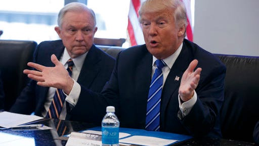 FILE - In this Oct. 7, 2016 file photo, Sen. Jeff Sessions, R-Ala. listens at left as then-Republican presidential candidate Donald Trump speaks during a national security meeting with advisers at Trump Tower in New York. As one of President-elect Donald Trump's closest and most consistent allies, Sessions is a likely pick for a top post in his administration. But the last time Sessions faced Senate confirmation it didn't go well.