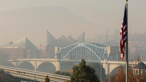 In this Wednesday, Nov. 16, 2016 photo, smoke from wildfires fill downtown Chattanooga, Tenn., and the Tennessee Valley with a pungent haze as seen from the North Shore area of Chattanooga.