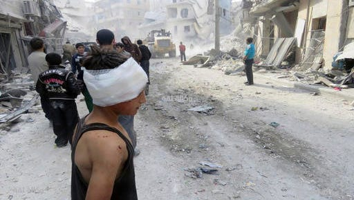 This image released by Thiqa News Agency shows an injured child after airstrikes in Aleppo, Syria, Wednesday, Nov. 16, 2016. Turkish warplanes on Monday struck Islamic State positions in and near the northern Syrian town of al-Bab while Ankara-backed Syrian opposition fighters inched closer to the town, one of the extremist group's largest remaining strongholds in the country, Turkish state media and Syrian activists said.