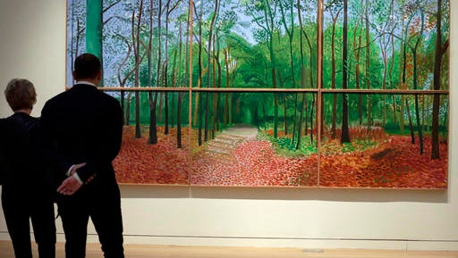 "FILE- In this Nov. 4, 2016 file photo, a large-scale landscape by David Hockney titled ""Woldgate Woods, 24, 25 and 26 October, 2006"" is displayed at Sotheby's, in New York. The painting sold at auction by Sotheby's in New York for $11.7 million on Thursday, Nov. 17, 2016. (AP Photo/Richard Drew, File)"