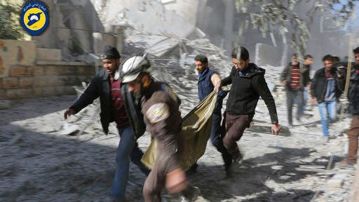This photo provided by the Syrian Civil Defense White Helmets, which has been authenticated based on its contents and other AP reporting, shows Civil Defense workers and Syrian citizens carry a dead body in the neighborhood of Seif al-Dawleh in Aleppo, Syria, Saturday, Nov. 19, 2016. Government bombardment of besieged rebel-held neighborhoods in the northern city of Aleppo killed at least 20 people Saturday Syrian opposition activists said, a day after the health directorate said all hospital in opposition areas have been knocked out of service.