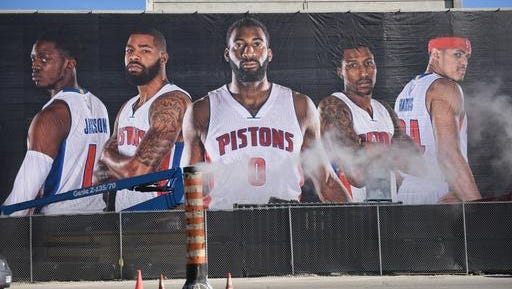 A banner featuring the Detroit Pistons hangs from Little Caesars Arena under construction in Detroit, Tuesday, Nov. 22, 2016. The Detroit Pistons have reached an agreement in principle with the city of Detroit and Olympia Entertainment for the team to move from the suburbs to downtown, according to a person with knowledge of the negotiations. The person spoke on condition of anonymity Monday because there had been no formal announcement. Pistons owner Tom Gores is set to appear at a news conference Tuesday with Detroit Mayor Mike Duggan and Christopher Ilitch, president and CEO of Ilitch Holdings. (Tanya Moutzalias/The Ann Arbor News-MLive.com Detroit via AP)