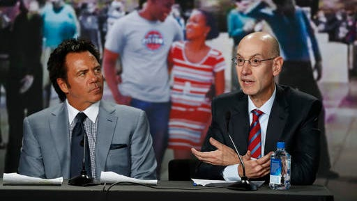 NBA commissioner Adam Silver, right, speaks as Detroit Pistons owner Tom Gores listens at a news conference in Detroit, Tuesday, Nov. 22, 2016. The Pistons announced they will move downtown Detroit and begin playing at the new Little Caesars Arena, home of the Detroit Red Wings, starting next season. (AP Photo/Paul Sancya)