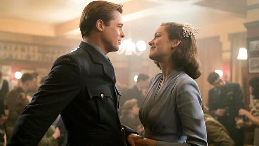 """In this image released by Paramount Pictures, Marion Cotillard, right, and Brad Pitt appear in a scene from """"Allied.""""  (Daniel Smith/Paramount Pictures via AP)"""