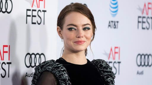 """FILE - In this Nov. 15, 2016, file photo, actress Emma Stone arrives at the 2016 AFI Fest screening of """"La La Land"""" at the TCL Chinese Theatre in Los Angeles. Stone told Vanity Fair for a cover story on Jennifer Lawrence published online in Nov. 2016 and in the magazine's holiday issue that she thought Lawrence was """"so great and vibrant and talented"""" that she would have a negative impact on Stone's career. Stone says she soon remembered she and Lawrence are """"completely different and there is room for everyone."""""""