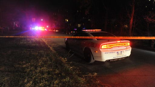 Authorities investigate after shooting of a Wayne State University officer Tuesday, Nov. 22, 2016, in Detroit. The officer was shot while on duty near the campus, the city's police chief said.