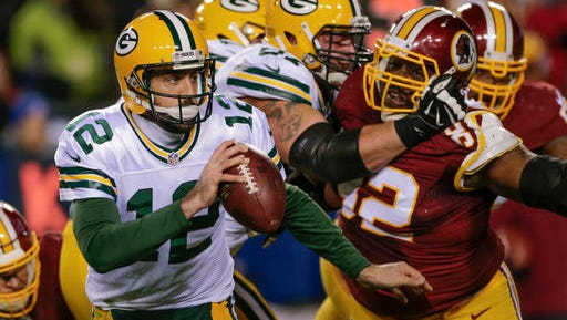 Green Bay Packers quarterback Aaron Rodgers (12) scrambles to avoid a rusher last Sunday in the Packers' 42-24 loss to Washington.