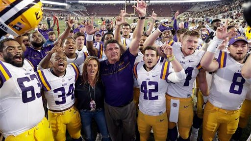 LSU coach Ed Orgeron celebrates with players after an NCAA college football game against Texas A&M Thursday, Nov. 24, 2016, in College Station, Texas. LSU won 54-39. (AP Photo/David J. Phillip)