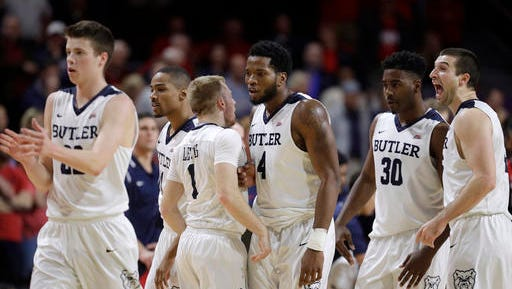 Butler players celebrate near the end of an NCAA college basketball game against Arizona