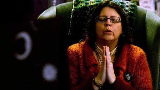 "In a show of solidarity with the Dakota Access oil pipeline protesters in Cannon Ball, ND., the co-owner of Ingress Yugen Audra Hollenbeck, 49, of Flushing, prays on Saturday, Nov. 26, 2016 at Ingress Yugen, a spiritual resource center, in Flint, Mich. ""Some people can say what we did tonight was silly but we know that every action has a reaction,"" said Derrik Gilliard, 44, of Flint, who co-owns Ingress Yugen. ""If we can show solidarity from many miles away, than maybe other individuals can also have the courage to stand in support of Standing Rock."""