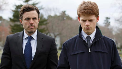"""This image released by Roadside Attractions and Amazon Studios shows Lucas Hedges, right, and Casey Affleck in a scene from """"Manchester By The Sea."""" The film has been named best film by the National Board of Review, which lavished four awards on Kenneth Lonergan's New England portrait of grief. In awards announced Tuesday by the National Board of Review, """"Manchester by the Sea"""" also took best actor for Casey Affleck's lead performance, best screenplay for Lonergan's script and best supporting actor for the breakout performance by Lucas Hedges."""