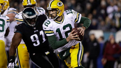 Eagles defensive tackle Fletcher Cox gives chase as Packers quarterback Aaron Rodgers looks to throw Monday night in the Eagles' 27-13 loss.
