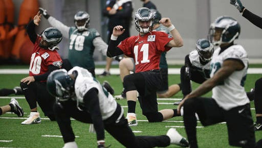 Eagles quarterback Carson Wentz (11) stretches during practice Wednesday as he and the team prepare for their game Sunday against Cincinnati.