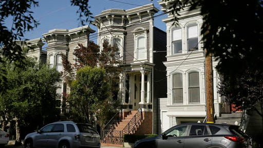 """FILE - This May 27, 2016, file photo, shows a Victorian home, center, in San Francisco, made famous by the television show """"Full House."""" The home was sold to producer Jeff Franklin, who created the show. The veteran TV producer bought the 3-bedroom Victorian, which was on the market for over $4 million, in August. The realtor had declined to say at the time who bought the home, which is in San Francisco's Lower Pacific Heights neighborhood. The home's exterior was used as the Tanner family's residence in the original show."""