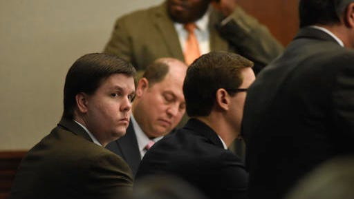FILE - In this Nov. 14, 2016 file photo, Justin Ross Harris sits with his defense team in the Glynn County Courthouse in Brunswick, Ga. Harris, whose toddler son died after being left for hours in a hot car, was convicted of murder by a jury that concluded a month's worth of trial testimony and evidence showed the father left his child to perish on purpose.