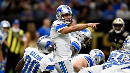 Detroit Lions quarterback Matthew Stafford (9) calls out from the line of scrimmage in the first half of an NFL football game against the New Orleans Saints in New Orleans, Sunday, Dec. 4, 2016. (AP Photo/Bill Feig)