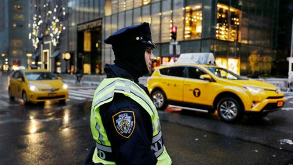 A New York City police officer stands watch outside Trump Tower, Monday, Dec. 5, 2016, in New York.
