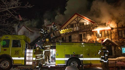 """Firefighters extinguish a blaze Sunday, Dec. 11, 2016, at Boyne Highlands Resort in Harbor Springs, Mich. The resort called it a """"significant structure fire"""" early Sunday."""