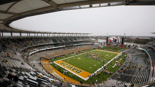FILE - In this Oct. 24, 2015, file photo, a nearly empty McLane Stadium is seen minutes before kickoff between Iowa State and Baylor in an NCAA college football game, in Waco, Texas. Baylor University will look to rebuild its reputation and perhaps its football program after an outside review found administrators mishandled allegations of sexual assault and the team operated under the perception it was above the rules. (AP Photo/Tony Gutierrez, File)