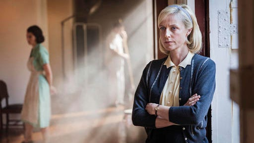 """This undated image released by Acorn TV shows Marta Dusseldorp as Sarah Nordmann in a scene from, """"A Place To Call Home."""" available on the streaming service Acorn TV."""