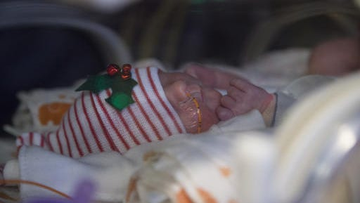 Ava Baudinet, one of a set of quintuplets recently born, rests at the St. Joseph's Nursery Intensive Care Unit, Wednesday, Dec, 21, 2016, in Phoenix. Margaret Baudinet gave birth on Dec. 4 to five healthy babies.
