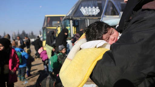 Syrians evacuated from the embattled Syrian city of Aleppo during the ceasefire arrive at a refugee camp in Rashidin, near Idlib, Syria, Tuesday, Dec. 20, 2016. Russian Foreign Minister Sergey Lavrov said on Tuesday that Russia, Iran and Turkey are ready to act as guarantors in a peace deal between the Syrian government and the opposition. He spoke on Tuesday after a meeting of the three countries' foreign ministers in Moscow.