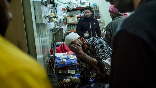A Iraqi man wounded in a car bomb attack in the liberated district of Gogjali in Mosul reacts to pain at an emergency room in a hospital in Irbil, Iraq, Thursday, Dec. 22, 2016.