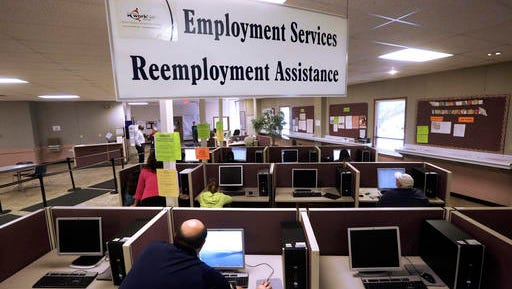 FILE - This Thursday, Sept. 29, 2016, file photo, shows the Illinois Department of Employment Security office in Springfield, Ill. On Thursday, Dec. 8, 2016, the Labor Department reports on the number of people who applied for unemployment benefits the week before. (AP Photo/Seth Perlman, File)