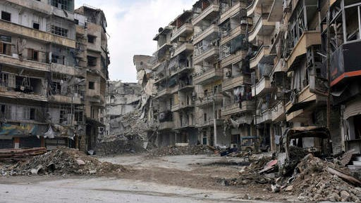 This photo released by the Syrian official news agency SANA, shows damaged buildings in the Sukkari neighborhood, east Aleppo, Syria, Friday, Dec 23, 2016. Syrian rebels outside Aleppo on Friday shelled a neighborhood in the northern city, killing three people in the first bombardment since government forces took control of the whole city after opposition fighters in the eastern parts withdrew, state TV reported.