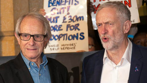 "FILE - In this Tuesday, Oct. 18, 2016 file photo, director Ken Loach, left, and leader of Britain's Labour Party, Jeremy Corbyn, pose together for photographers upon their arrival at the premiere of the film ""I, Daniel Blake"" in London. The film, which won the Cannes Film Festival's Palme d'Or, has powerfully struck a nerve, tapping into the same working-class frustrations that are upending politics in Europe and the U.S. (Photo by Joel Ryan/Invision/AP)"