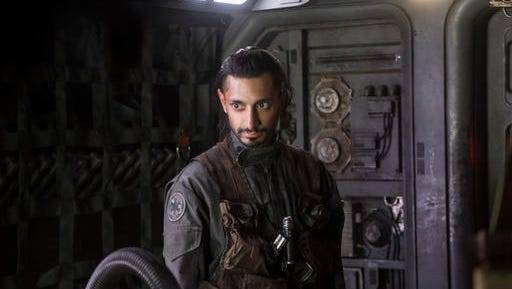 """This image released by Lucasfilm Ltd. shows Riz Ahmed as Bodhi Rook in a scene from, """"Rogue One: A Star Wars Story."""""""