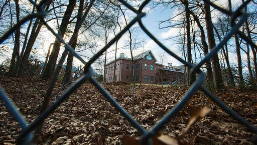 A fence encloses an estate in the village of Upper Brookville in the town of Oyster Bay, N.Y., on Long Island on Friday, Dec. 30, 2016. On Friday, the Obama administration closed this compound for Russian diplomats, in retaliation for spying and cyber-meddling in the U.S. presidential election.