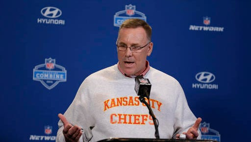 This Feb. 25, 2016 photo shows Kansas City Chiefs general manager John Dorsey speaking during a news conference at the NFL football scouting combine in Indianapolis. A year ago, in the days after the Chiefs were eliminated from the postseason by the New England Patriots, Dorsey was faced with a series of decisions that would shape whether Kansas City would be a contender the following season.