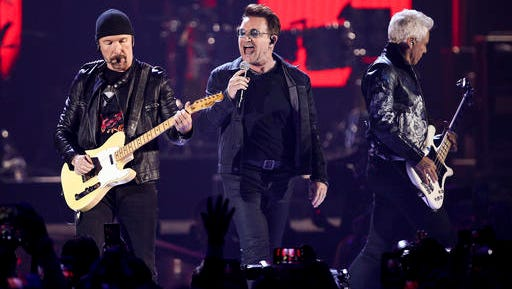 In this Sept. 23, 2016, file photo, The Edge, from left, Bono and Adam Clayton of U2 perform at the 2016 iHeartRadio Music Festival at T-Mobile Arena in Las Vegas.