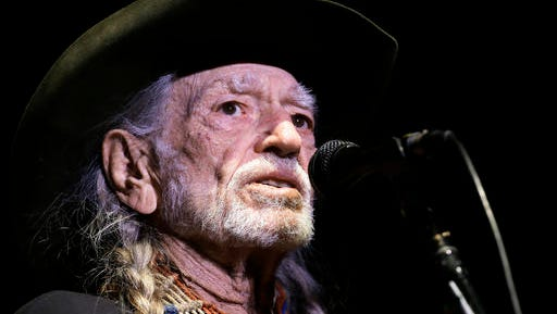 """In this Jan. 7, 2017 photo, Willie Nelson performs in Nashville, Tenn. The 83-year-old outlaw country icon wants to help a lot of people give marijuana a try. He's attached his name to a line of legal marijuana being sold in Colorado and Washington called """"Willie's Reserve,"""" after decades of personally advocating for the legalization of marijuana.  (AP Photo/Mark Humphrey)"""