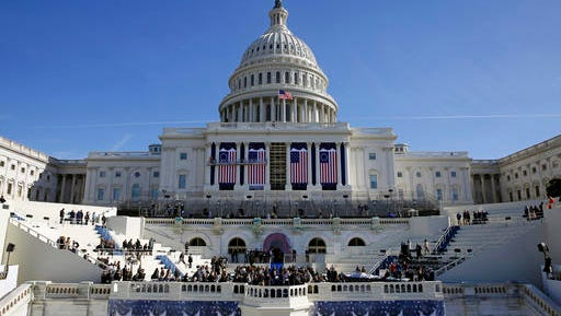 In this Jan. 15, 2017, photo, the U.S. Capitol frames the backdrop over the stage during a rehearsal of President-elect Donald Trump's swearing-in ceremony in Washington. Some two dozen House Democrats plan to boycott Trump's inauguration on Friday, casting the Republican businessman as a threat to democracy. (AP Photo/Patrick Semansky)