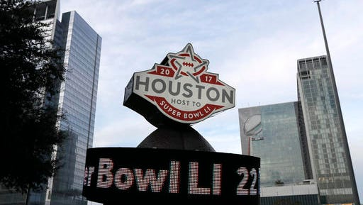 This Jan. 14, 2017 photo shows a countdown sign leading up to Super Bowl LI in Discovery Green park in downtown Houston. Super Bowl LI will be played Feb. 5 at NRG Stadium in Houston.