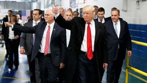 FILE - In this Dec. 1, 2016, file photo, President-elect Donald Trump and Vice President-elect Mike Pence wave as they visit to Carrier factory in Indianapolis, Ind. Donald Trump enters the White House on Jan. 20 just as he entered the race for president: defiant, unfiltered, unbound by tradition and utterly confident in his chosen course. In the 10 weeks since his surprise election as the nation's 45th president, Trump has violated decades of established diplomatic protocol, sent shockwaves through business boardrooms, tested long-standing ethics rules and continued his combative style of replying to any slight with a personal attack _ on Twitter and in person.