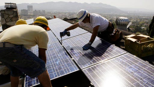 Workers from California Green Design install solar electrical panels on the roof of a home in Glendale, Calif. California, Hawaii, Oregon, New York and many other Democratic-leaning states have ambitious goals to wean themselves off fossil fuels, but doing so requires an investment in renewable energy that could be in jeopardy now that Donald Trump has assumed the presidency.