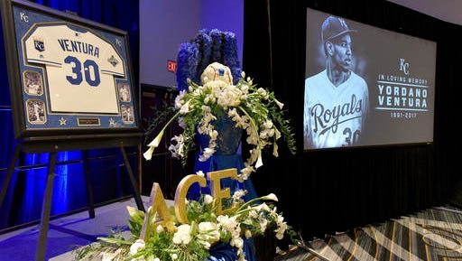 Flowers, images and a jersey are among the items at the front of the room where Kansas City Royals' Yordano Ventura was remembered by members and employees of the team in Kansas City, Mo. Ventura died in a car crash in the Dominican Republic. (