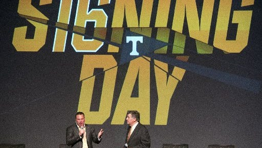 Tennessee coach Butch Jones and Vol Networks Bob Kessling greet the crowd at the Tennessee Theatre during a presentation of the new recruits for National Signing Day on Feb. 3, 2016.