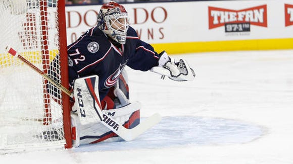 Columbus Blue Jackets' Sergei Bobrovsky, of Russia, plays against the Carolina Hurricanes during an NHL hockey game Saturday, Jan. 21, 2017, in Columbus, Ohio. (AP Photo/Jay LaPrete)